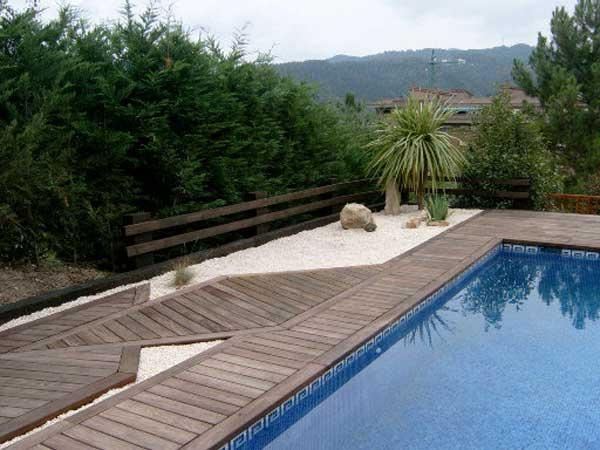 como decorar un jardin con piscina